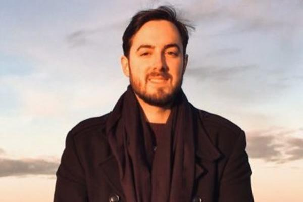 Dr Daniele Nunziata smiling against sunset sky