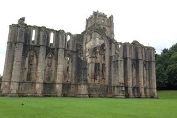 The ruins of the church at Fountains Abbey, surrounded by neat lawns
