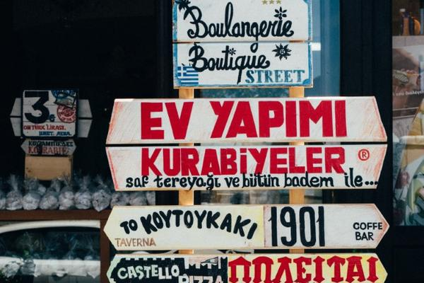 Signpost with signs in multiple languages