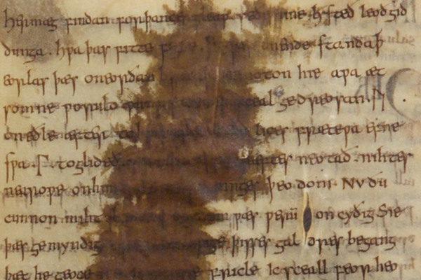 borwn ink over medieval script