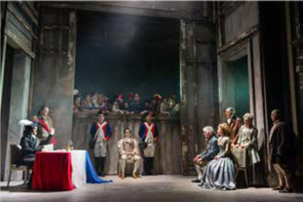 Stage setting with actors performing a play