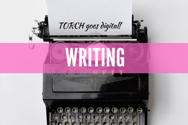 Black typewriter, words read TORCH Goes Digital, Writing