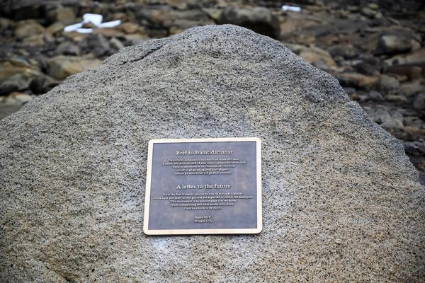 Bronze plaque on a rock within a rocky landscape