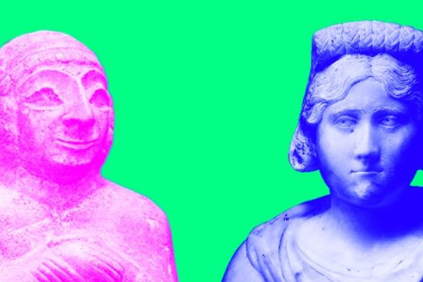 Two old statues re-coloured in bright pink and blue against a green backdrop