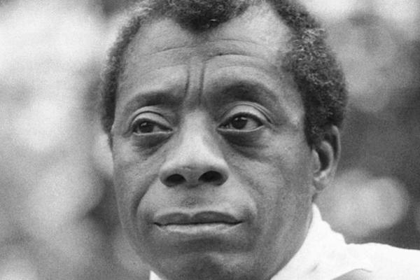 Black and white photograph of James Baldwin