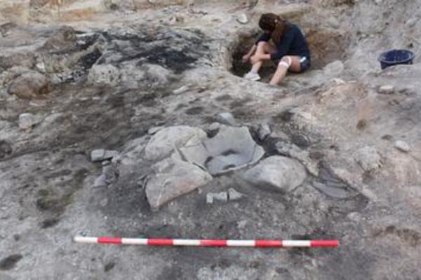 Archaeologist working on a dig.