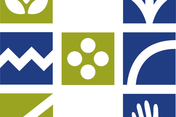 Rebuilding Heritage Logo in green, blue and white.