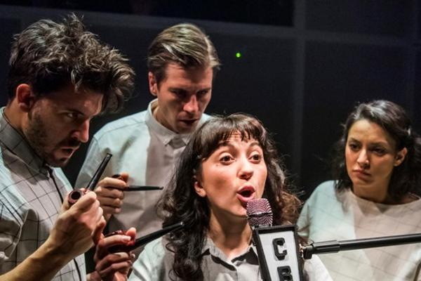 Oxford Playhouse Image of people in white shirts gathered around microphone