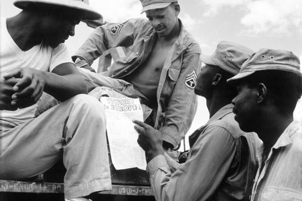 troops in burma stop work briefly to read president trumans proclamation of victory in europe