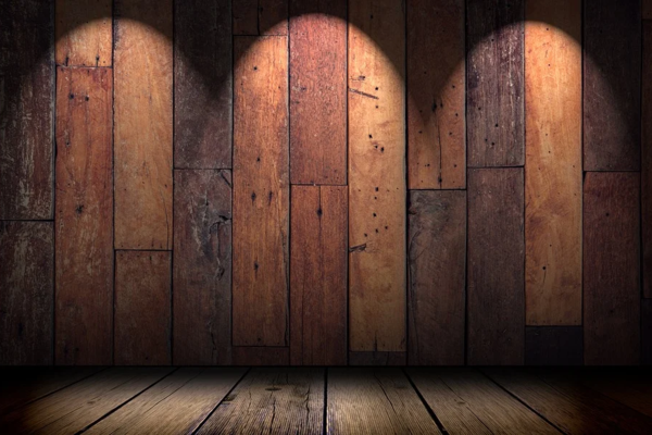 Empty stage with wooden backdrop