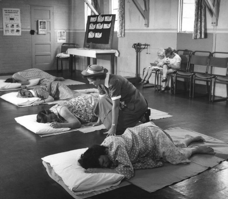 Black and white photograph of women preparing for labour in antenatal class