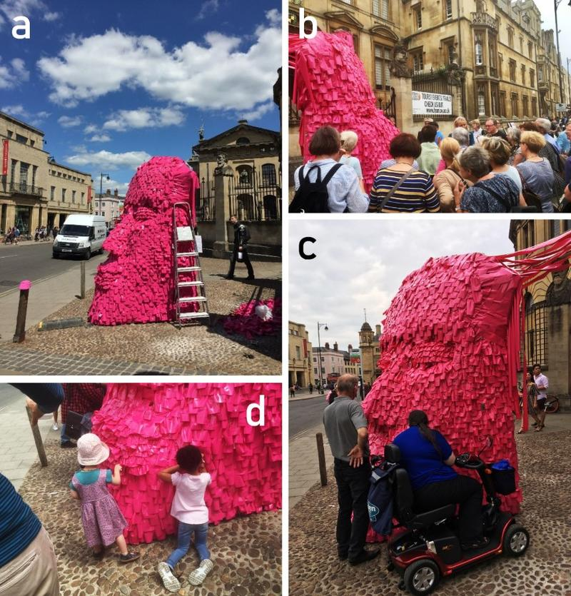 Collage of four pictures depicting people participating in the 'Pink Head' engagememnt activity. The 'Pink Head' was covered in post-it notes. Amongst the audience we see people of all ages.