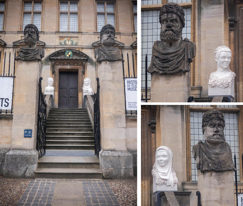 Behind the 'regular' heads two female portraits in gypsum flank the entrance to the building. The old heads are front-facing, whereas the temporary ones are looking to the side.