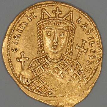 gold coin showing woman as the central image