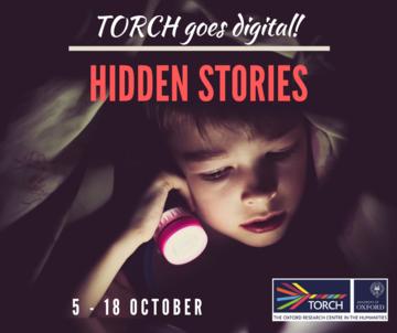 Child reading under a duvet by torchlight