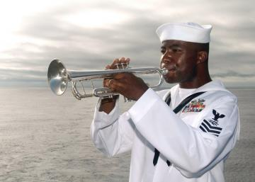 us navy 040718 n 7781d 038 a bugler plays taps during a wreath laying ceremony held on the flight deck in memorial of captain franklin hooks ii