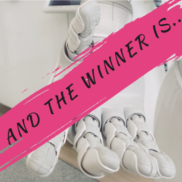"""Robotic hand stretch out, covered by pink banner which reads """"And the winner is..."""""""