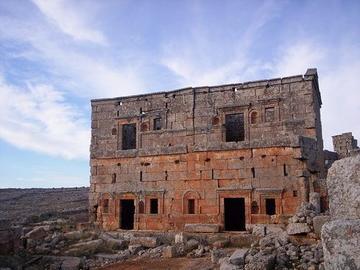 image of building with large brick masonry, orange stone