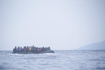 refugees on a boat crossing the mediterranean sea heading from turkish coast to the northeastern greek island of lesbos 29 january