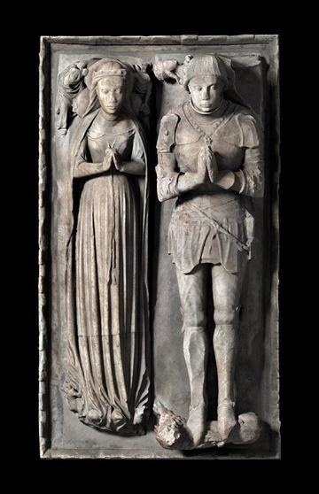 Efigy of woman and knight side by side in burial monument