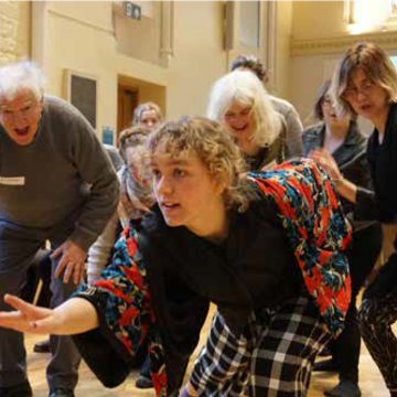 Image taken at workshop 'Moving together combating loneliness and enhancing connectivity through movement' showing dancers moving together.