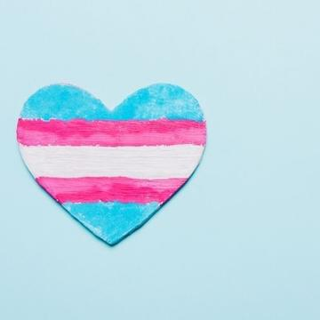 a light blue background with the heart painted with blue, pink and white, then pink and blue lines horizontally
