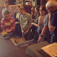 delegates are shown the rare books collection at christ church library