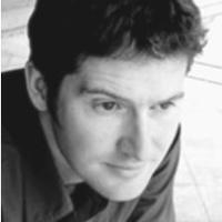 black and white heatshot of man in dark shirt, short hair
